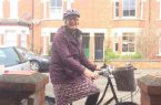Vicar Gill busy on a bike